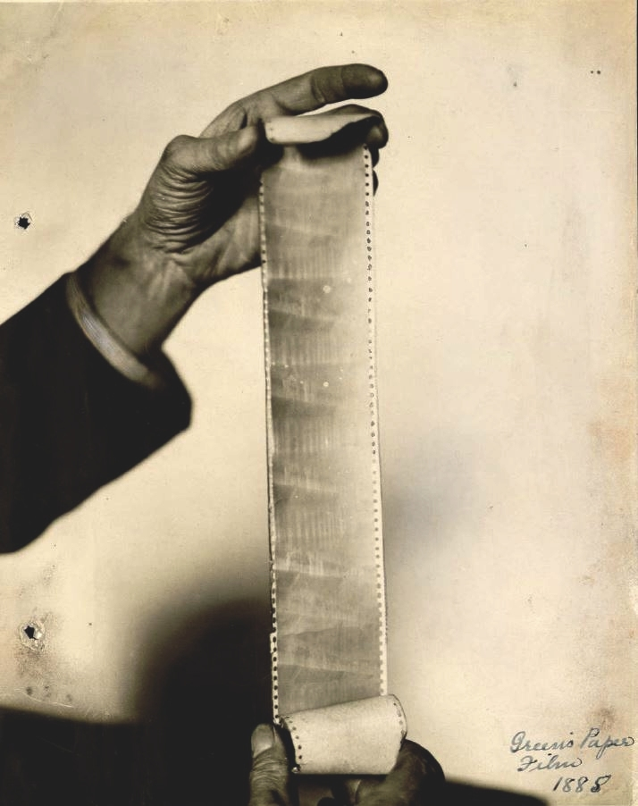 Will Day holds up paper film - from book edit