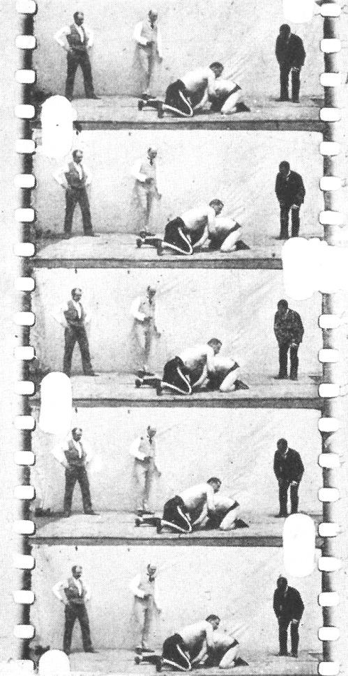 Film strip from Eidoloscope Latham - poss wrestling on rooftop